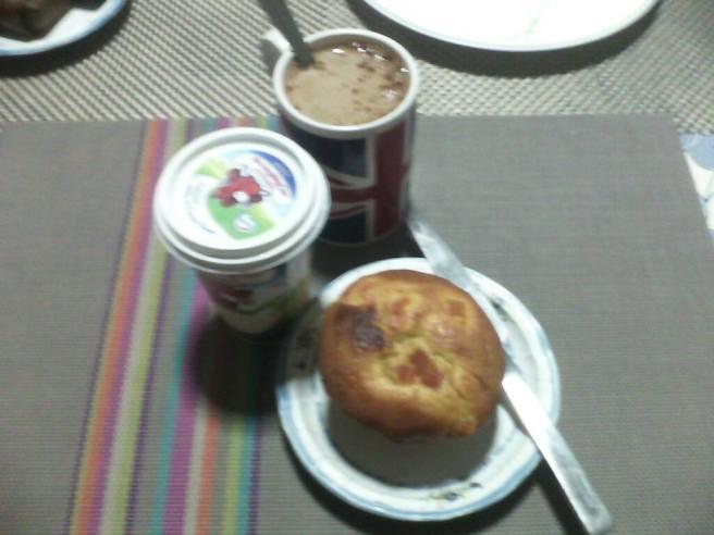 A pumpkin muffin and coffee