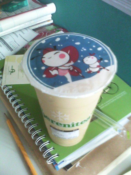 Mango jasmine milk tea with custard pudding
