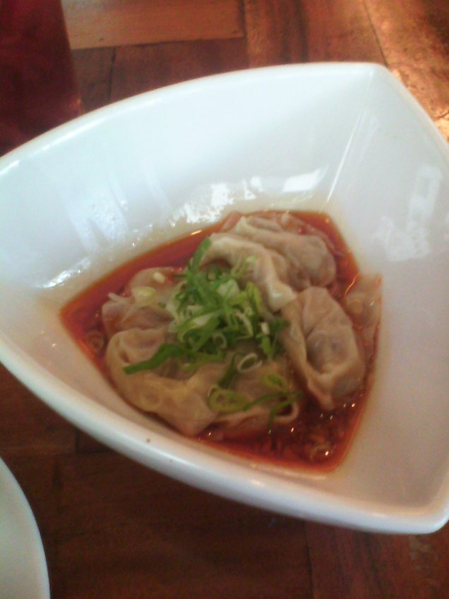 Spicy vegetable and pork wontons