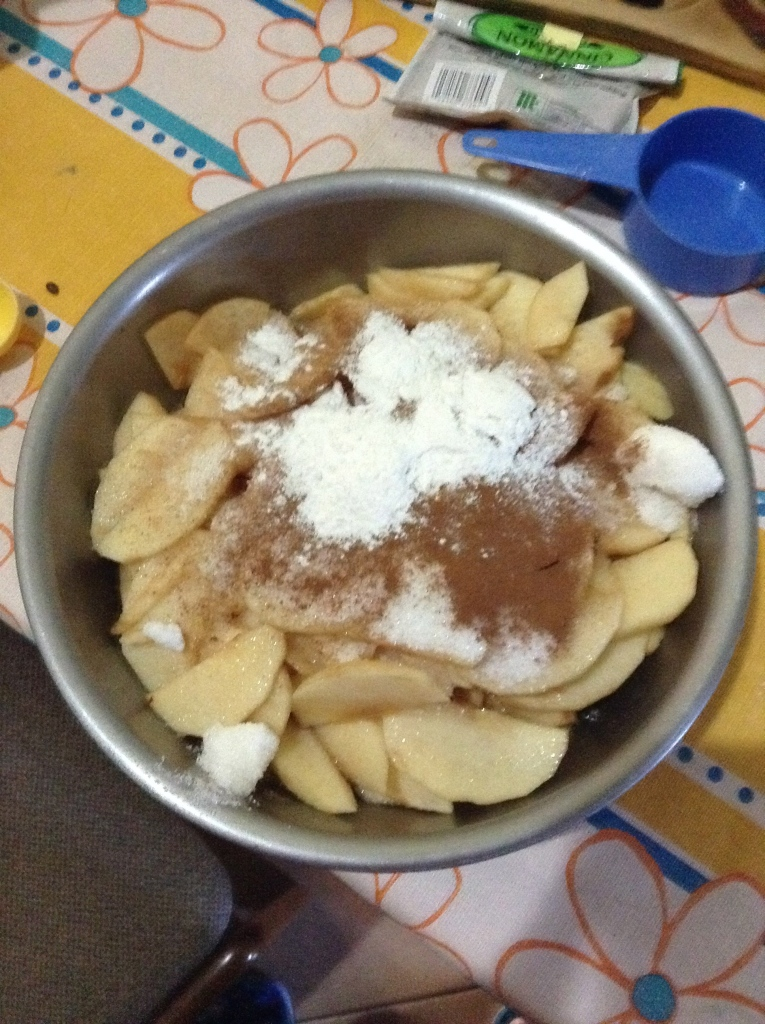 Toss apples in sugar, cinnamon, and a touch of flour...